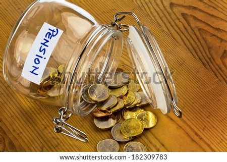 gold coins in a jam jar. the provision for old age is always less. poverty in retirement / pension? - stock photo