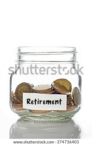 Gold coins in jar with Retirement label isolated in white background - stock photo