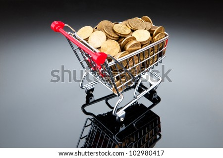 Gold coins in shopping cart - stock photo
