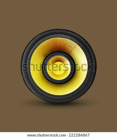 gold color speaker on brown background - stock photo