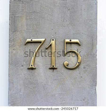 gold colored house number seven hundred and fifteen - stock photo