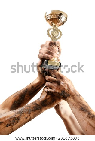 Gold cup in hands isolated on white - stock photo