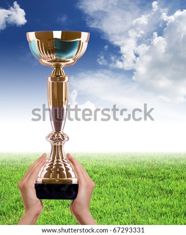 Gold cup on a blue sky - stock photo