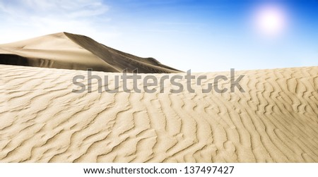 Gold desert into the sunset. Beautiful Sand Dune. Grand Canary; Maspalomas - stock photo