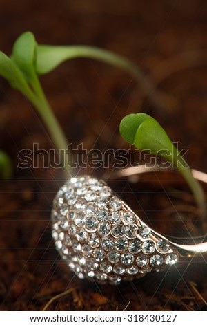 Gold Diamond Ring with Green Plants - stock photo