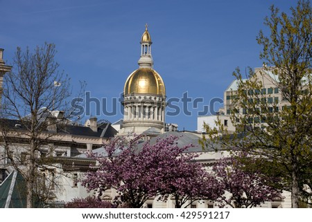 Gold dome of the New Jersey State Capitol Building in Trenton on a beautiful spring day.    - stock photo
