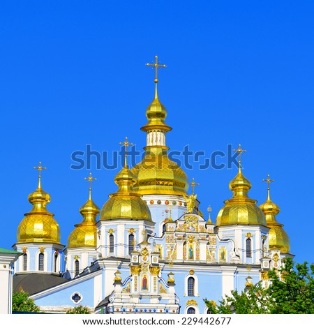 Gold Domes of St. Michael's Cathedrall in Kiev against the blue sky. Capital of Ukraine - Kyiv. - stock photo