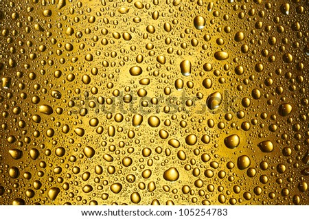 Gold drops not to a bottle - stock photo