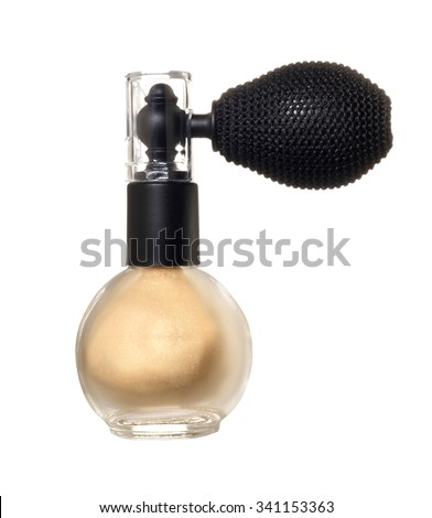 Gold dust in a bottle with spray on white background. Photo  - stock photo
