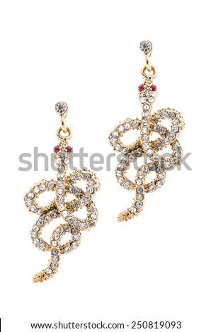 Gold earrings in the form of a snake  inlaid with precious stones - stock photo