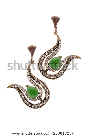 Gold earrings in the form of harps  inlaid with  gemstones on a white background - stock photo