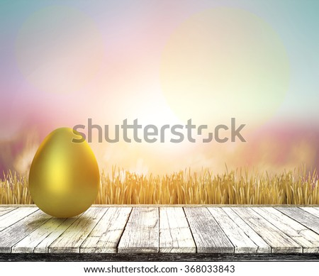 Gold egg for easter day on pastel background - stock photo
