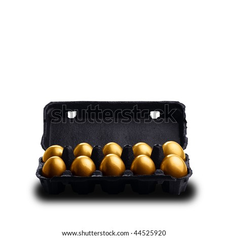 Gold eggs in a black carton isolated on white background - stock photo