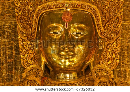 Gold face of Buddha - stock photo