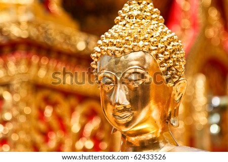 Gold face of Buddha statue in Doi Suthep temple, Chiang Mai, Thailand. - stock photo