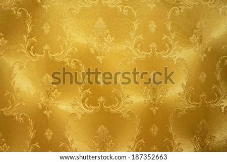 Gold flower vintage fabric background - stock photo