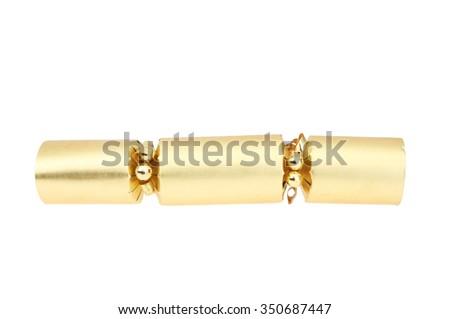Gold foil Christmas cracker isolated against white - stock photo