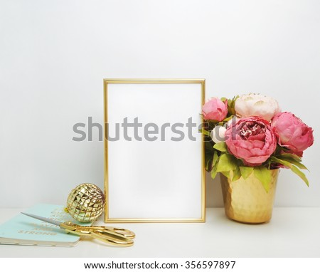 Gold frame mock-up, and white wall with gold vase, and peonies Place work - stock photo