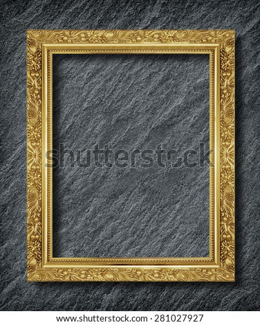 gold frame on  black slate background - stock photo