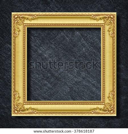 gold frame on Dark grey black slate background or texture. - stock photo