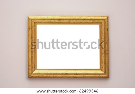 Gold frame on the wall - stock photo