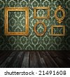 Gold frames, retro wallpaper, spotlights from above, please check for more - stock photo