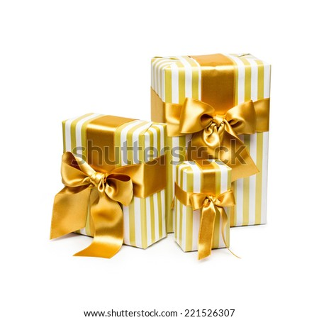 Gold gift boxes isolated on white background - stock photo