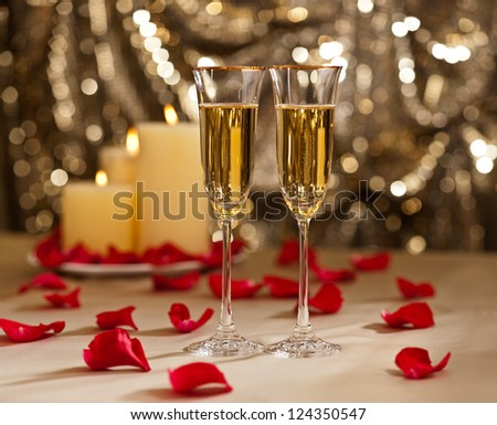 Gold glitter Wedding reception setting with champagne and candles - stock photo