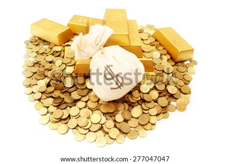 Gold ingots with gold coins and money bag - stock photo
