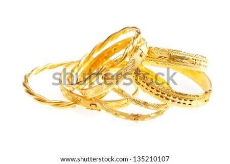 gold jewelry, Golden bracelets , isolated on white background - stock photo