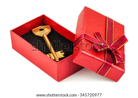 gold key in red gift box on white background - stock photo