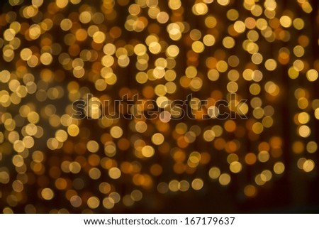 gold light spots on a yellow background  - stock photo
