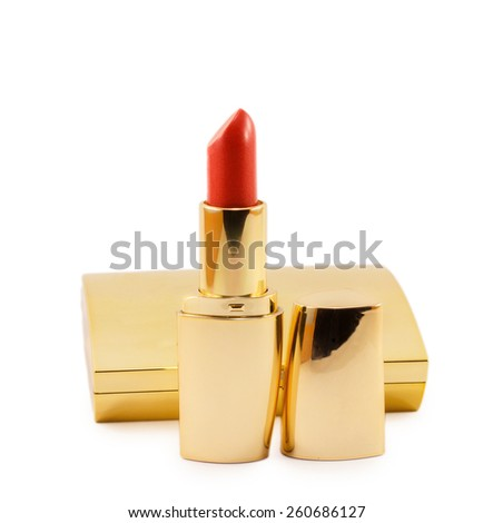 gold lipstick and powder isolated on white background - stock photo