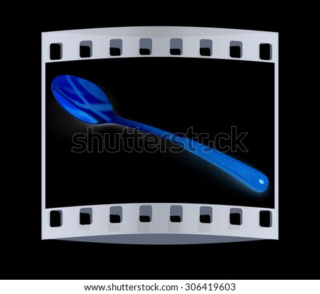 gold long spoon on blsck background. The film strip - stock photo