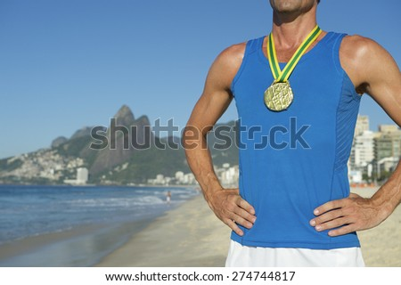 Gold medal athlete standing outdoors on Ipanema Beach Rio de Janeiro Brazil  - stock photo