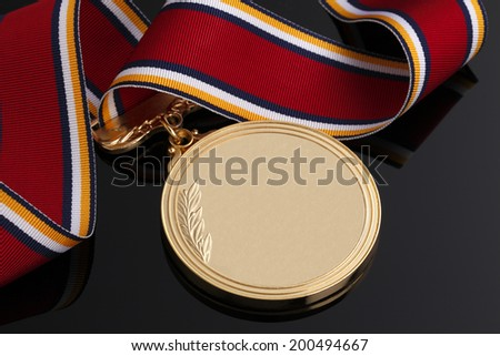 Gold medal on Black background - stock photo