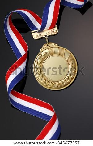 Gold medal on black background?? - stock photo