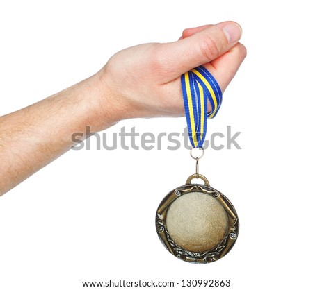 Gold Medal winner in the hand. On a white background. - stock photo