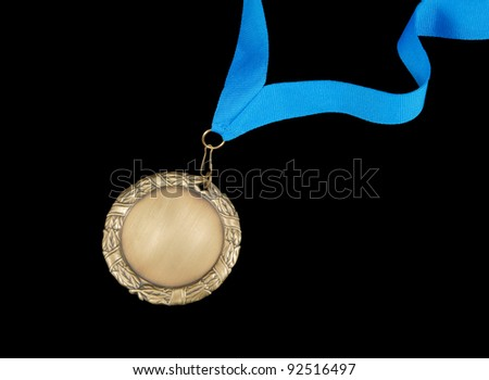 Gold medal with blue ribbon isolated on black - stock photo