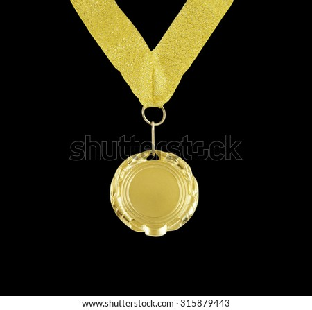Gold medal with golden ribbon isolated on black background - stock photo
