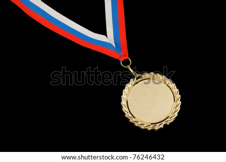 Gold medal with ribbon isolated on black background - stock photo