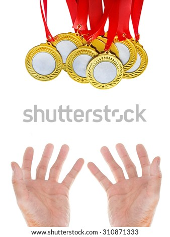 Gold Medals with hands - stock photo