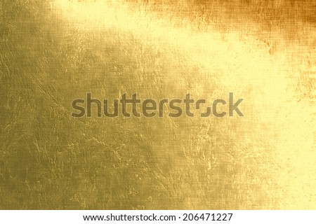 Gold metallic background, linen texture, bright festive background  - stock photo