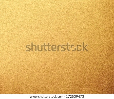 Gold metallized paper background - stock photo
