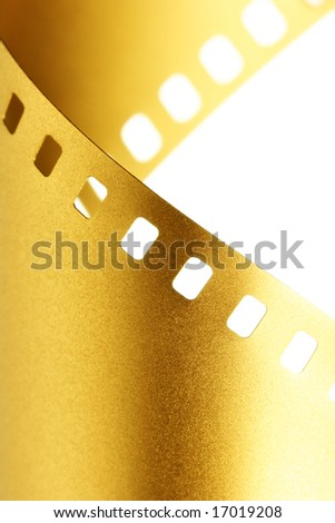 Gold 35 mm film macro isolated over white background - stock photo