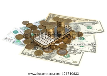 Gold mobile phone in the heap of coins and banknotes on a white background - stock photo