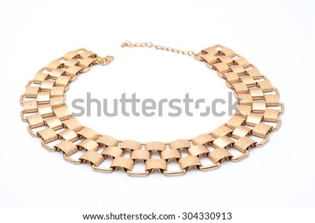 gold necklace isolated on white - stock photo