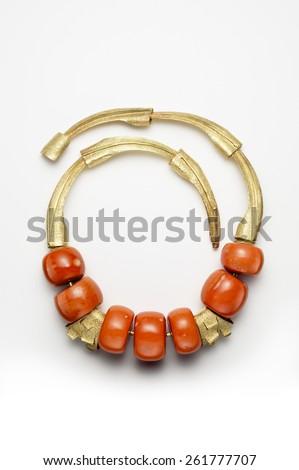 Gold Necklace with Orange Gems - stock photo