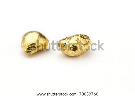 Gold nuggets isolated against a white background - stock photo