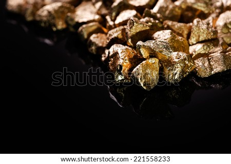 Gold nuggets isolated on black background. - stock photo